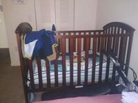 baby's brown wooden crib Tampa, 33610