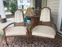 two brown wooden framed white padded armchairs MISHAWAKA