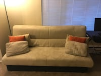 brown fabric sofa with throw pillows