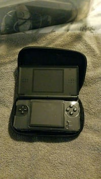 black Nintendo DS with case 3179 km