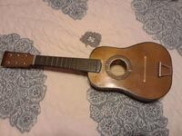 brown and black acoustic guitar Del Valle, 78617