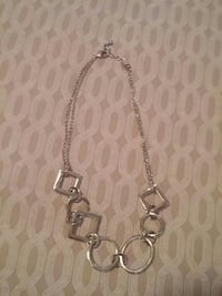silver-colored necklace.