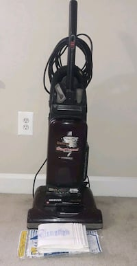 black Bissell upright vacuum cleaner