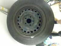 black bullet-hole vehicle wheel with tire