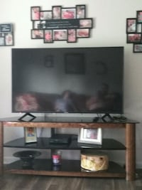 black flat screen TV with brown wooden TV stand Bonaire, 31005