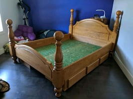 Beautiful Queen Oak Bed frame with 3 drawers on either side.