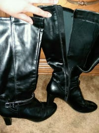 pair of black leather knee-high boots Junction City, 66441