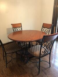 Wood Table and 4 Piece chair set. Great condition  New Britain, 06053