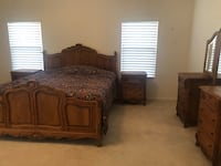 brown wooden bed frame with white mattress Bakersfield, 93308