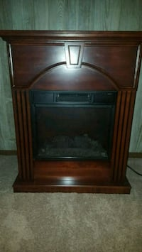 brown wooden framed electric fireplace Springfield, 22153