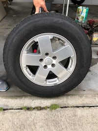 Set of Jeep Wrangler rims and tires. 255-70-18
