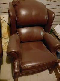 2 brown leather arm chairs
