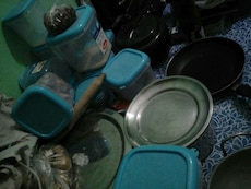 blue and clear plastic containers with black round metal fryer