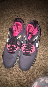 pair of purple-and-black Nike running shoes Washington, 20024