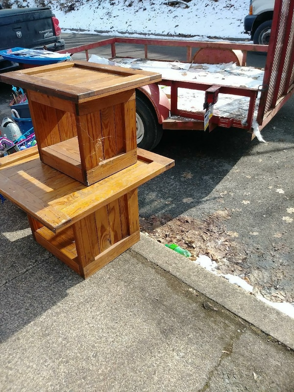 two brown wooden side tables
