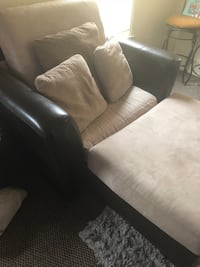 Black and beige leather sofa chair