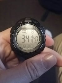 round black digital watch with black strap St. Catharines, L2M 3E6