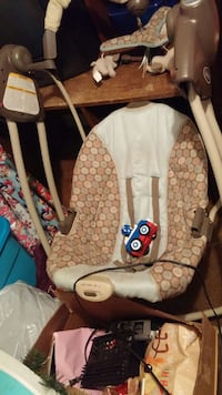 baby's brown and white Graco portable swing Phenix City, 36869