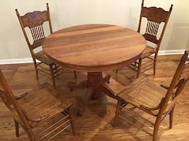 """42"""" oak table w/ 4 press back cane chairs. Great game table"""