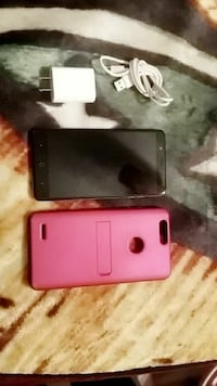 black Android smartphone with charger and case