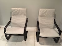 two black wooden framed white padded armchairs Hamilton, L8L 4T6
