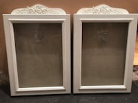 two white wooden photo frames 786 km