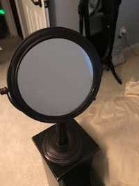 Rubbed bronze double sided mirror