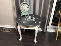Round accent table refinished in white and dark grey top featuring large antique clock designs 478 km