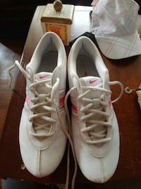pair of white-and-red Nike running shoes San Antonio, 78205