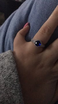 Silver-colored ring with blue gemstone 3726 km