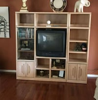 wooden entertainment center with television North Little Rock, 72116