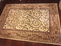 brown and white floral area rug Burnaby, V5J 2E9