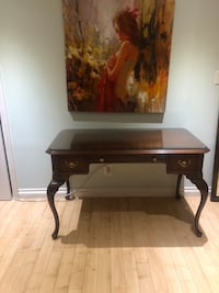 Elegant table with a glass . Excellent condition!