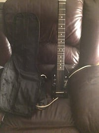Black and brown electric guitars case and extra cords Ottawa, K1K 2Z9