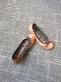 pair of brown leather flats Springfield