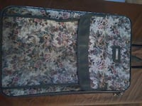 white, maroon, and black floral softshell luggage 2280 mi