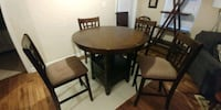 round brown wooden table with four chairs dining set Montgomery, 36106