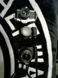 three black DSLR cameras
