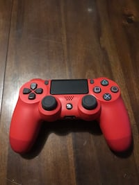 red and black Sony PS4 DualShock 4 273 mi