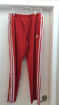 red and white Adidas track pants 729 km