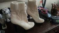 pair of white leather high heeled booties Springfield, 97477