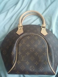 black and brown Louis Vuitton leather backpack Fort Erie, L2A 2N1