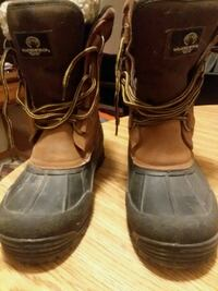 brown-and-black duck boots 707 mi