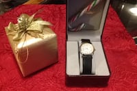 round silver analog watch with black leather strap in box Victoria, V9A 2E6