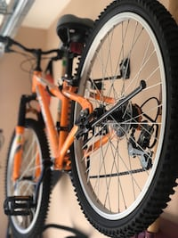 "orange mountain bike 16"" wheels brand new never been use, good for teens  Vancouver, V5Y 1L1"