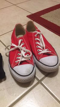 Pair of red low top Converse.