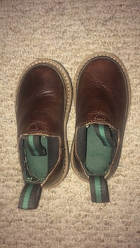 toddler's pair of brown leather boots