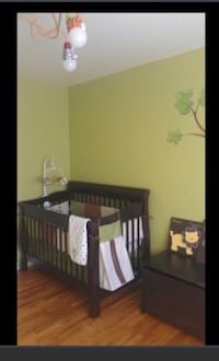 brown wooden crib with changing table screenshot Saint-Eustache, J7R 5G3