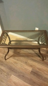 Glass table with wrought iron frame London, N5W 6A1
