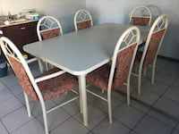 Dinner Table expands and has 8 chairs 1373 mi